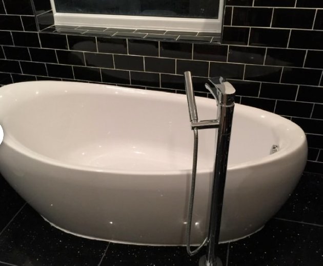 Rolled top bath with waterfall tap installed